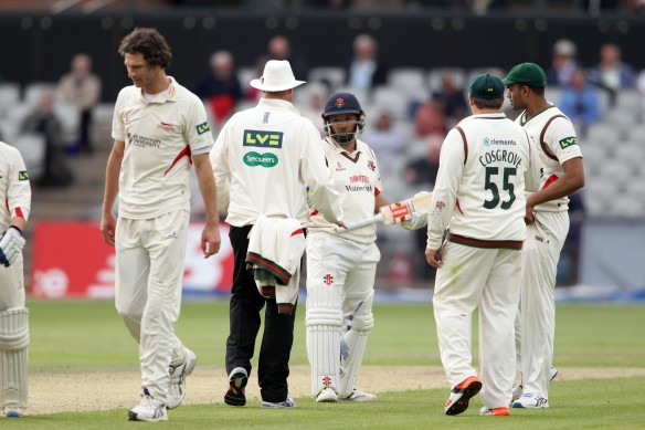 LANCASHIRE COUNTY CRICKET CLUB Emirates Old Trafford Lancashire v Leicestershire LV= County Championship Division Two, 15/06/15 Ashwell Prince with umpires
